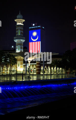 Masjid Jamek (Jamek Mosque) at night, Malaysian Flag in background. Kuala Lumpur, Malaysia. - Stock Image