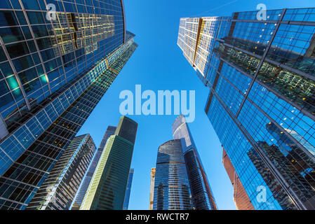 perspective bottom up view on business district skyscrapers - Stock Image