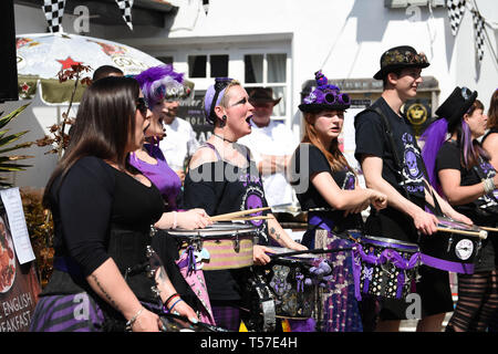 Bolney Sussex, UK. 22nd Apr, 2019. The Stix Drummers entertain the crowd at the annual Bolney Pram Race in hot sunny weather . The annual races start and finish at the Eight Bells Pub in the village every Easter Bank Holiday Monday Credit: Simon Dack/Alamy Live News - Stock Image