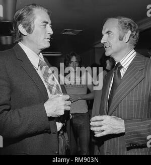 Actor Gregory Peck talks with Presidential candidate George McGovern before a fundraising concert in April 15, 1972 at The Forum in Los Angeles featuring Jame Taylor, Carole KIng, Barbra Streisand and Quincy Jones. - Stock Image