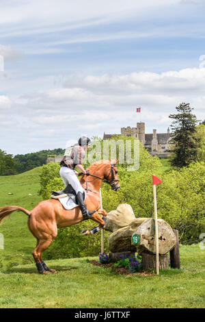 Rockingham Castle, Corby, UK. 21st May, 2017. Richard P Jones and his horse Killaboy Bob clear a log obstacle with - Stock Image