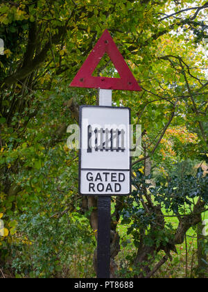 Old fashioned Gated Road traffic sign now used to warn of a level crossing ahead, Ryedale Folk Museum, Hutton le Hole North Yorkshire England UK - Stock Image