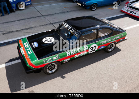 Aerial view of a 1980 3L Ford Capri Race Car, owned by John and Charles Brown, in the  Pit Lane, at the Silverstone Classic Media Day 2019 - Stock Image