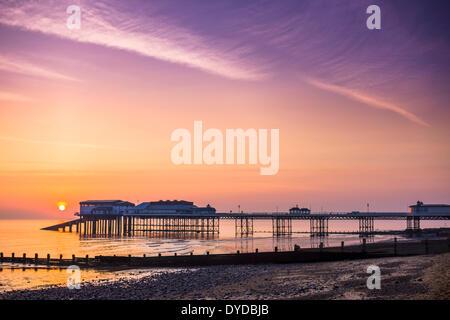 Cromer pier at sunrise. - Stock Image