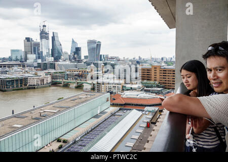 London England United Kingdom Great Britain Bankside River Thames Tate Modern art museum terrace view city skyline downtown skyscrapers rooftops gray - Stock Image