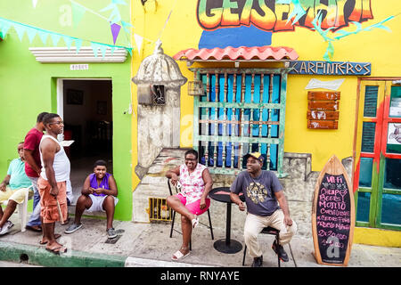 Cartagena Colombia Old Walled City Center centre Getsemani neighborhood doorway Karpinteros bar wall mural exterior Black Afro Caribbean Hispanic man - Stock Image