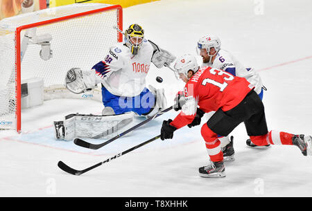 Bratislava, Slovakia. 15th May, 2019. L-R Goaltender Henrik Holm (NOR), Nico Hischier (SWE) and Jonas Holos (NOR) in action during the match between Switzerland and Norway within the 2019 IIHF World Championship in Bratislava, Slovakia, on May 15, 2019. Credit: Vit Simanek/CTK Photo/Alamy Live News - Stock Image