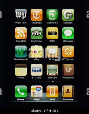 Image of the iphone touch screen. Display shows a collection of useful apps with orange and green color scheme. - Stock Image