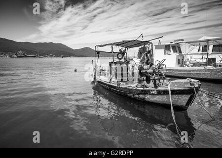 Small traditional Greek fishing boat in a port. - Stock Image
