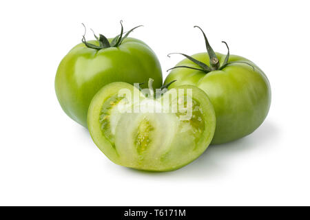 Whole and halved fresh green unripe tomatoes isolated on white background - Stock Image