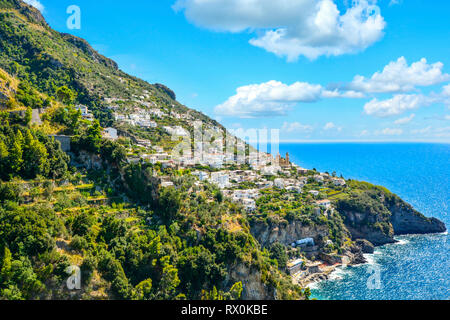 A view of a hilltop town Praiano, Italy from a scenic drive along the Amalfi Coast on the Italian Mediterranean - Stock Image