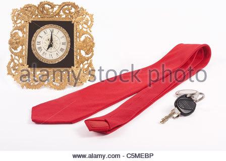 Ornate Metal Clock with Tie - Stock Image