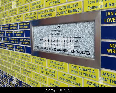 Carnegie Challenge Cup memorial plaque at Halliwell Jones stadium, Mike Gregory Way / Winwick Rd, Warrington, WA2 - Stock Image
