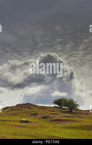 Looming storm clouds over the Lakeland Fells, Windermere, Cumbria, England, UK - Stock Image