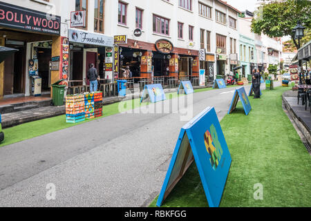 Singapore - 21st December 2018: Artificial grass and barriers on Circular Road. This is a major entertainment area. - Stock Image
