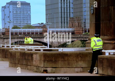 "Glasgow, Scotland, UK 4th July, 2019.Euro Hostel River Suicide scuffle led to police cordoning off the hostel and the Clyde walkway by the South Portland Street Suspension Bridge and the la passionata Spanish civil war statue famous for its better to ""die on your feet than live  forever on your knees"" quote: Gerard Ferry/ Alamy Live News - Stock Image"