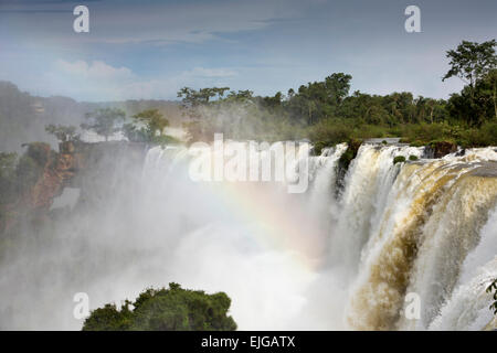 Argentina, Iguazu Falls, water flowing over waterfalls after heavy rain - Stock Image