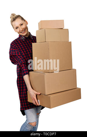 woman carrying stack of cardboard boxes isolated on white background - Stock Image