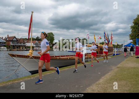 Henley Royal Regatta  Semi Finals  -The Princess Grace Challenge  Cup .The Chinese National Rowing Team run along the Thames  towpath in the Boat Tent area ,past 'Gloriana' the 90-foot-long British royal barge, as their  last stretching  exercises  before their race in the semi finals against the  Advanced Rowing Initiative of the Northeast, U.S.A.    Credit Gary Bake/Alamy Live - Stock Image