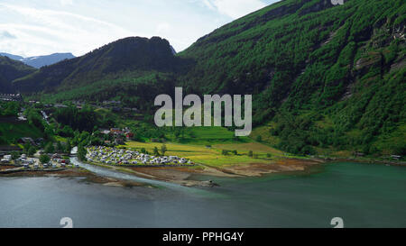 Spectacular elevated views of Geiranger village at the end of the UNESCO-protected Geiranger fjord, Norway - Stock Image