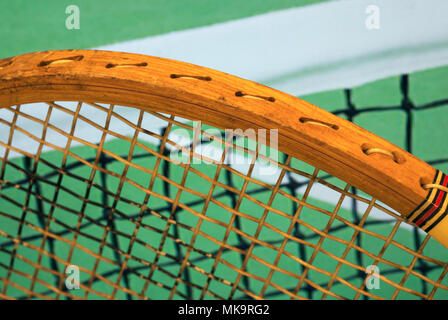 tennis racket and court net - Stock Image