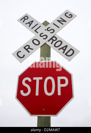 stop and railroad crossing signs - Stock Image