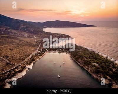 Sunrise over Thasos Island Aliki beach and yacht harbour - Stock Image