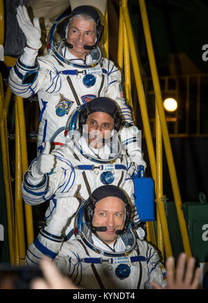 Expedition 53 flight engineer Mark Vande Hei of NASA, top, flight engineer Joe Acaba of NASA, and Soyuz Commander - Stock Image
