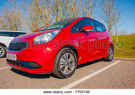 A brand new red Kia Venga parked at Abington Services  registered March 2016 in England with a registration plate - Stock Image