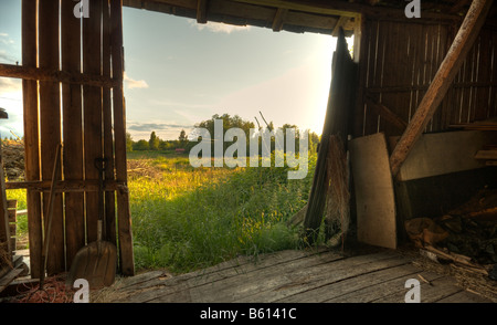 Summer landscape through barn door - Stock Image