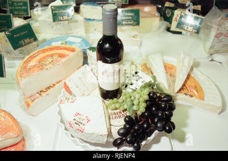 Cheese Selection, displayed in shop. 22nd February 1999. Chateau Beaumont Red Wine. - Stock Image