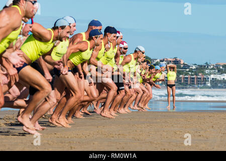 Lifesavers racing at Moolooloba in Queensland. - Stock Image