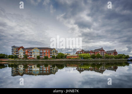 dramatic sky over modern architecture along river Lagan in Belfast, Northern Ireland - Stock Image