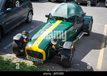 Caterham Superlight R300 English two-seater sports carwith sunshade in a public car park in UK - Stock Image