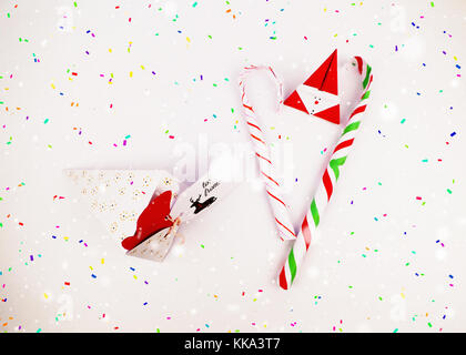 Christmas decoration diy cake slice gift box with candy canes for celebration with falling confetti best Christmas - Stock Image