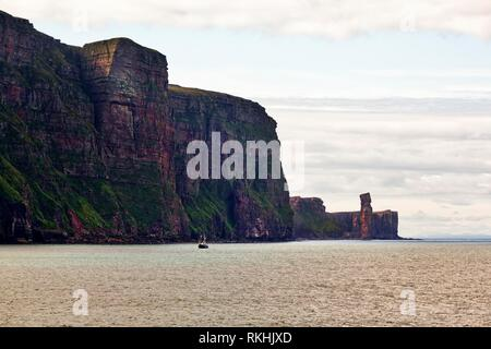 Steep coast, cliffs and rock needle Old Man of Hoy, Hoy Island, Orkney Islands, Scotland, Great Britain - Stock Image