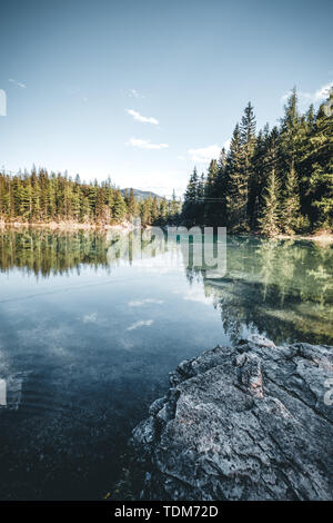 Green Lake in Styria with mountain in the background , Austria - Stock Image