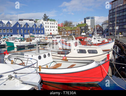 Torshavn, Faroe Islands. 7th May, 2019. Sunshine in Torshavn in the Faroe Islands, despite snowfall early this morning due to an Arctic Blast. The sunshine reflects off the yachts and boats moored in the harbour. Credit: Keith Larby/Alamy Live News - Stock Image
