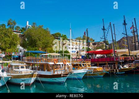 Tourist cruise boats, Kaleici Yat Limani, old town yacht harbour, Antalya, Turkey, Eurasia - Stock Image