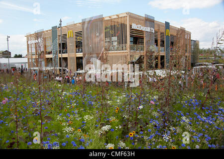 Wildflowers outside MacDonalds Restaurant on a sunny day at Olympic Park, London 2012 Olympic Games site, Stratford - Stock Image