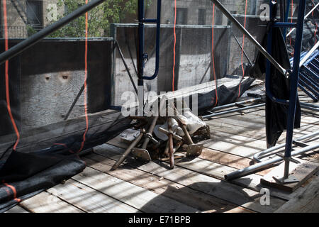 scaffold parts from inside building - Stock Image