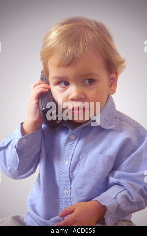 Child on a cordless phone - Stock Image