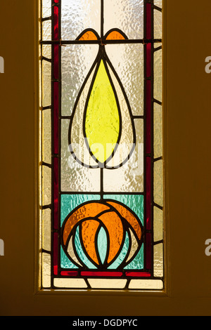 Stained glass window in a door - Stock Image