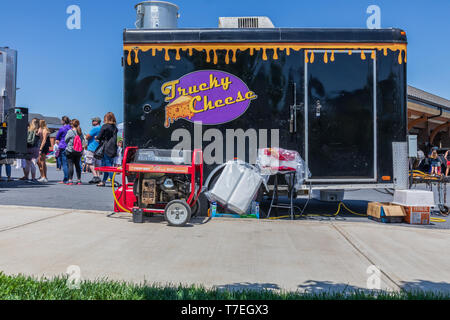 JOHNSON CITY, TN, USA-4/27/19: The back side of a food vendor's trailer, with a generator and other supplies. - Stock Image