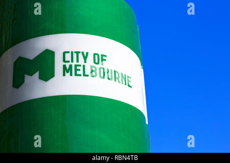 Close up detail of a giant Christmas cracker featuring the City of Melbourne logo.Victoria Harbour in Melbourne Docklands,Victoria Australia. - Stock Image