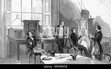 The electric telegraph office at Nine Elms railway station, London       Date: 1845 - Stock Image