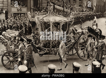 The coronation of George the sixth on May 12 1937 showing the king and queen in the Gold State Coach published in a souvenir book dated 1937 - Stock Image