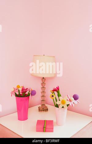 Vases with a lampshade on a night table - Stock Image