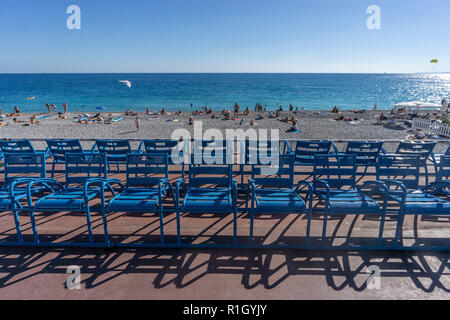 Blue chairs at Promenade des Anglais in Nice, French Riviera, Cote d Azur, France - Stock Image