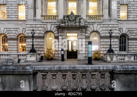 Exterior and one entrance of the neoclassical Somerset House in central London, England, with illumnated Christmas Trees. - Stock Image
